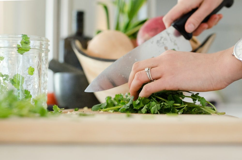 A woman chopping vegetables