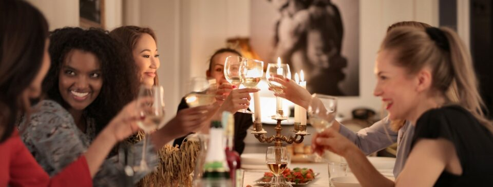 : A group of girls at a dinner party